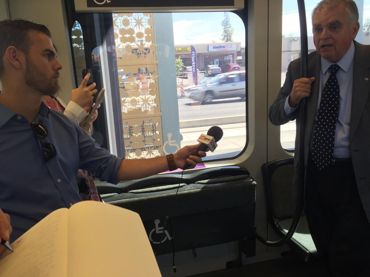 Ray LaHood fielding questions from press while riding Phoenix's light rail system